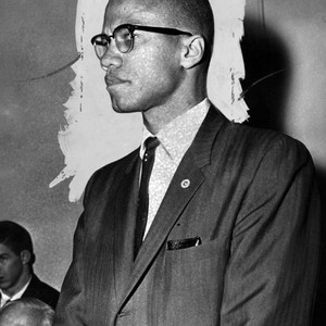 Malcolm X at meeting