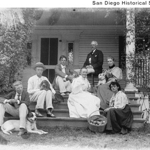 Members of the John Kendall family seated on the porch steps of ...