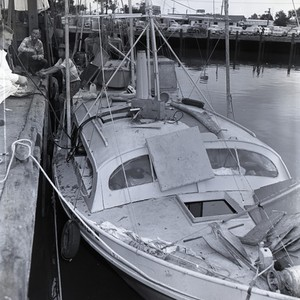 Unidentified boat docked in Newport Harbor, Newport Beach, California: Photograph