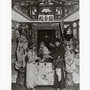 In the temple of General Kwan the actor Li Hsueh-fang officiates as ...