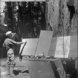 Artist sketching poster, Bohemian Grove. [negative]