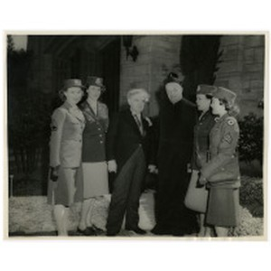 Isidore B. Dockweiler with WAC personnel and Roman Catholic priest, circa early ...