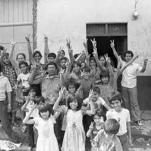 A group of people holding their fingers in victory signs, Nicaragua, 1979