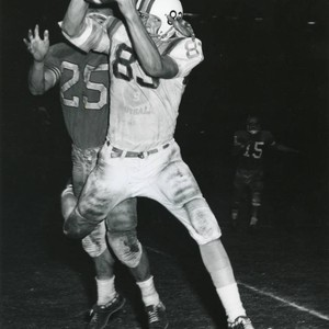 "Football--Robert ""Tink"" Hultz running with the ball"