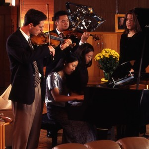 Marjorie Rawlins with students? Piano and violins.