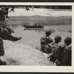 Members of the 232nd engineers observe the maneuvers of one of their ...
