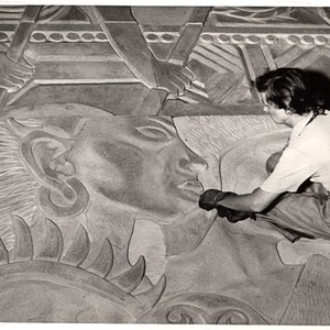[Artist Esther Bruton working on the mural 'Peacemakers' that will decorate the ...
