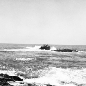 An offshore rock four miles north of camp at San Isidro with ...