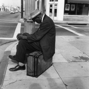 Man asleep on suitcase