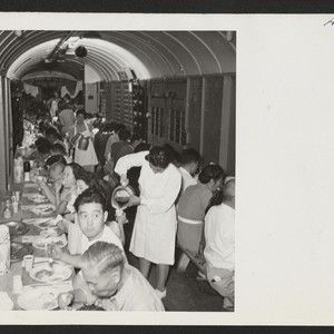 Dinner time in the improvised baggage car where transferees were fed by ...