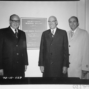 The three Mayer brothers standing next to the dedication plaque for the ...