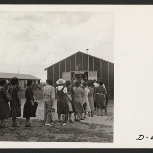 Admiring lines of evacuees filed through a recreation hall, which exhibited floral ...