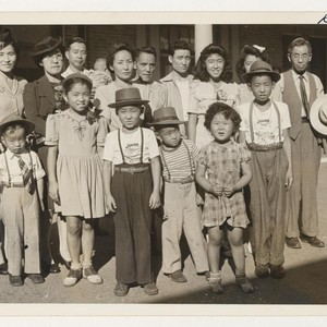 Shown are some arrivals in Madera, California, from the Rohwer Relocation Center. ...
