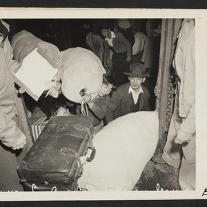 Los Angeles, Calif.--Evacuees of Japanese ancestry entraining for Manzanar, Calif., 250 miles ...