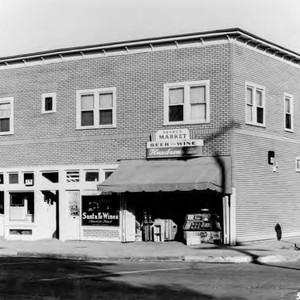 Photogrpah of a building. The shops include, Henry's Market, Santa Fe Wines, ...