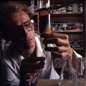 Unidentified professor in science lab, conducting an experiment.