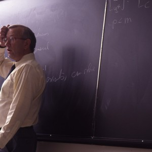 Unidentified professor lecturing to his classroom.
