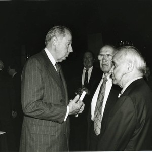 Peter Drucker standing next to Walter Wriston and an individual