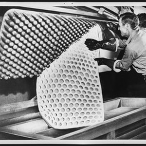 Man stripping a piece of completed c-foam from a mold at the ...