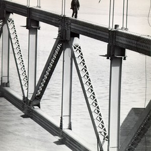 [Worker walking along a steel structure during construction of the San Francisco-Oakland ...