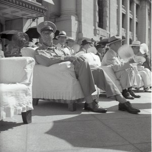 General Mark Clark sitting in chair during President Rhee event