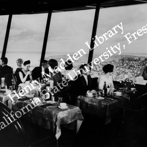 Fairgoers having dinner at the top of the Space Needle