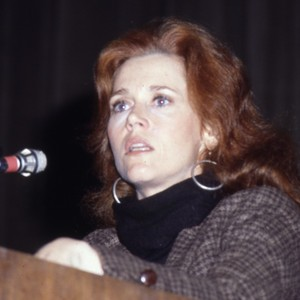 Woman Speaking at the Podium