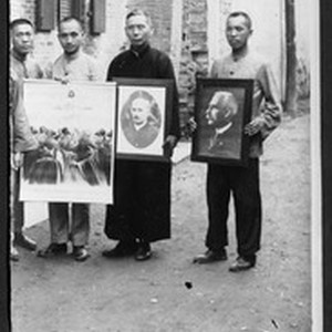 Chinese men holding portraits of missionaries and Jesus, Fuzhou, Fujian, China, ca.1910