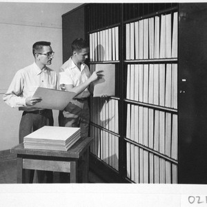 James McClanahan and Hendrik Rubingh filing sky survey plates in a vault ...