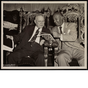 William Green and A. Philip Randolph talking