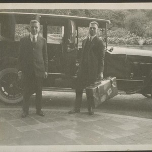[Two men at automobile]