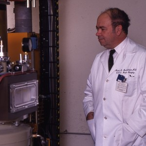 Professor Monte Buchsbaum, B.I.C., with cyclotron.