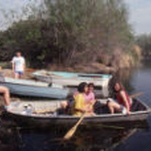 Students sitting on boats