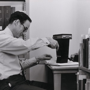 A photograph of Ray Reeder with a strange photographic device processing catalog ...