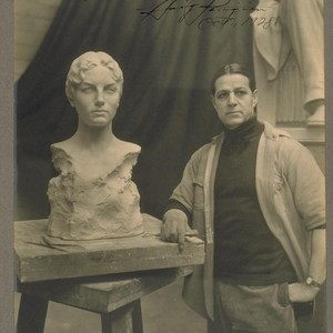 [Haig Patigian with sculpture of tennis player Helen Wills.]