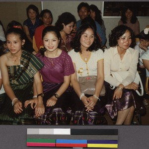Group of ladies sitting at a New Year's party, San Jose, California