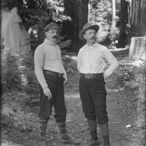 Two men, standing, wearing knickers and hats, Bohemian Grove. [negative]