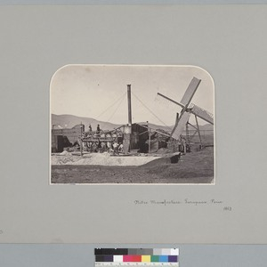"""Nitrate Manufacture, Tarapaca, Peru, 1863,"" with laborers and windmill. [photographic print]"