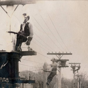 P G & E lineman on poles in Chico