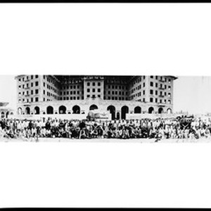 Group portrait of people gathered in front of the Beverly Wilshire Apartment ...
