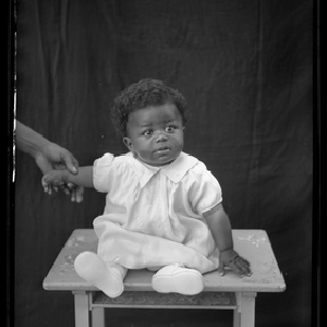 Portrait of a baby sitting on a bench