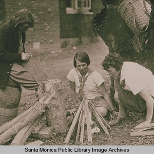 Three young girls (Girl Scouts) building a campfire in Temescal Canyon, Pacific ...