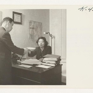 Lily Nakanishi, in San Francisco, hands an appointment slip for work to ...