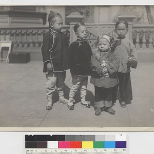 [four children on sidewalk]