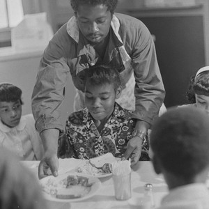 Man serving food to girl, St. Augustine's Episcopal Church