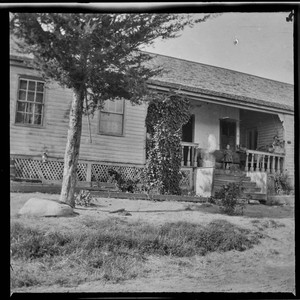 Unidentified house with child on porch
