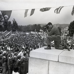 War photographer filming at a political rally