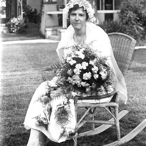 Portrait of a bride sitting outside, California: Photograph