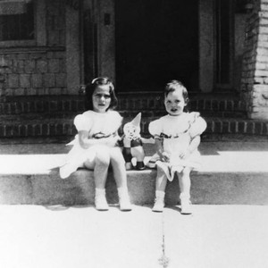 Two girls with clown doll