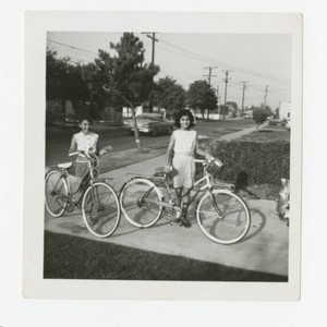 Young women with their bicycles, Los Nietos, California